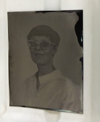 Collodion photography: This is a glass negative floating in the water bath after its been developed.