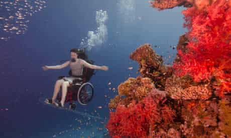 Sue Austin scuba diving in her electric wheelchair. Image: Guardian