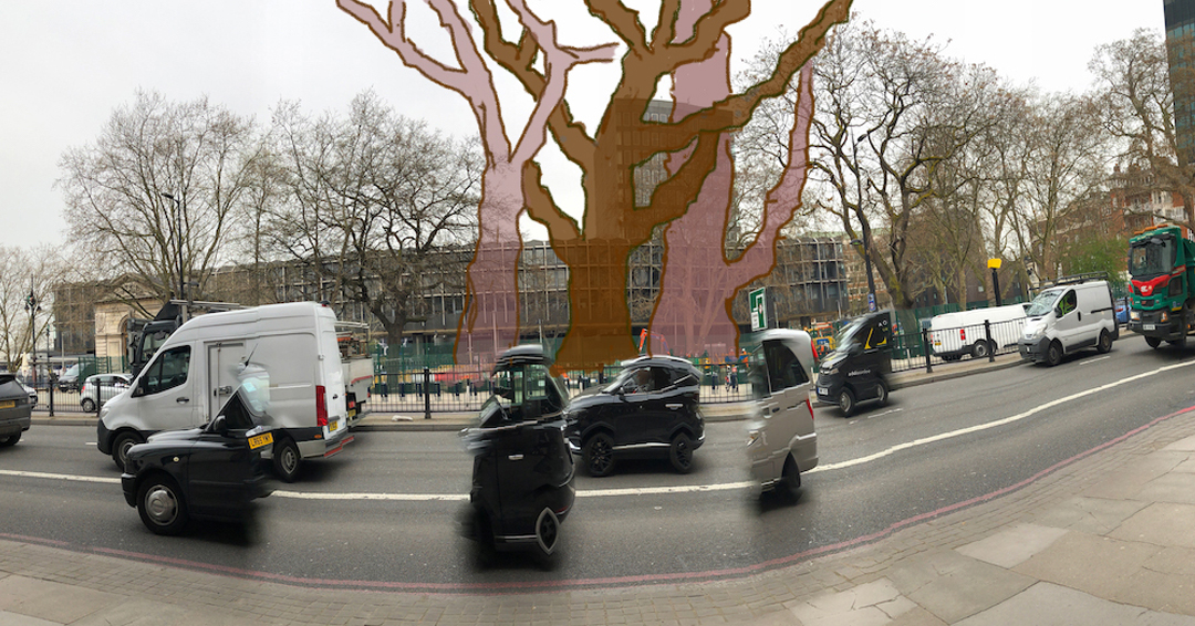 Looking across euston road towards the station , the ghosts of the murdered plane trees reach far far up. In front, the vehicles have been ghosted